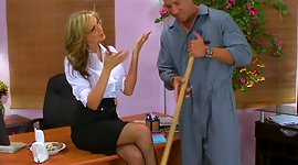 Busty blond female boss Julia Ann is..