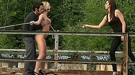 Euro model holds punished in outdoor